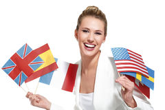 Beautiful woman showing international flags. On white Royalty Free Stock Photo