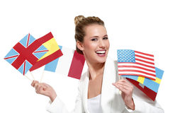 Beautiful woman showing international flags Royalty Free Stock Photo