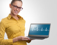 Beautiful woman showing a laptop. Health care concept Stock Images