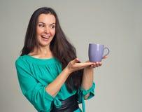 Beautiful woman showing a mug Stock Photography