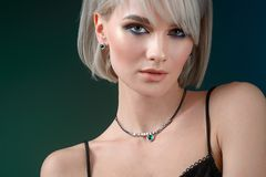 Beautiful woman showing off her jewelery in fashion concept wearing accessories stock images