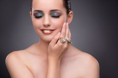 The beautiful woman showing off her jewellery in fashion concept Royalty Free Stock Images