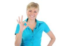 Beautiful woman showing ok. Isolated on white background stock image