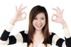 Beautiful woman showing OK sign Stock Photo