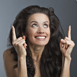 A beautiful woman is showing a sign Stock Photos