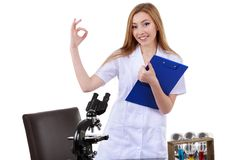 Beautiful woman showing sign ok laboratory science Stock Images