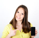 Beautiful woman showing a smart phone with thumb up isolated on Stock Image