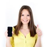 Beautiful woman showing a smart phone with thumb up isolated on Royalty Free Stock Photography