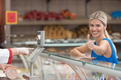 Beautiful Woman Showing Thumbs Up In Supermarket Stock Image