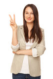 Beautiful woman showing victory sign or peace Royalty Free Stock Image
