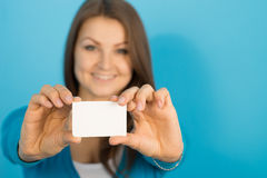 Beautiful woman shows blank card Stock Photography
