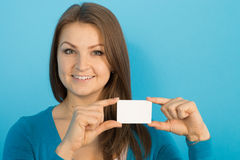 Beautiful woman shows blank card Stock Photo