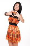 Beautiful woman shows a heart symbol Stock Photo