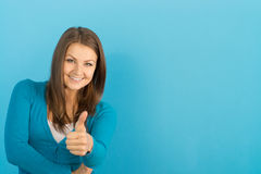 Beautiful woman shows thumb up Stock Images