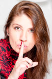 Beautiful woman shows that you need to keep quiet Royalty Free Stock Images
