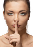 Beautiful woman with silence sign Stock Photo