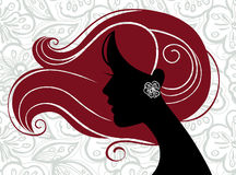 Beautiful woman silhouette. On floral background Stock Photography