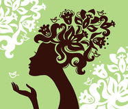 Beautiful woman silhouette. With a flowers Royalty Free Stock Photos