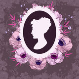 Beautiful woman silhouette in floral frame Stock Photography