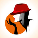 Beautiful woman silhouette with stylish hat Stock Images