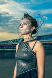 Beautiful woman in a silver dress with crystals on the face Royalty Free Stock Photos