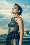 Beautiful woman in a silver dress with crystals on the face Stock Images