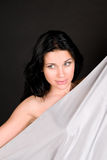 Beautiful woman with silvery silk Royalty Free Stock Photo