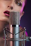 Beautiful woman singing Stock Images