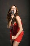 Beautiful woman singing Stock Photo