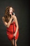 Beautiful woman singing Stock Image