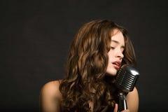 Beautiful woman singing Royalty Free Stock Image