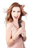 Beautiful woman singing into a hair styling brush Stock Photo