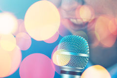 Beautiful woman singing karaoke song with microphone Stock Photo