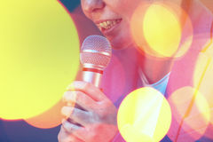 Beautiful woman singing karaoke song with microphone Stock Photography