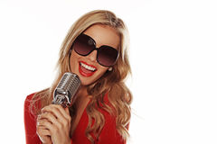 Beautiful Woman Singing Into Microphone Stock Photography