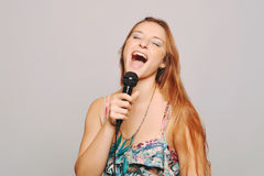 Beautiful woman singing with microphone. Stock Images