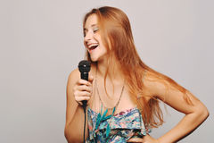 Beautiful woman singing with microphone. Stock Photography