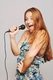 Beautiful woman singing with microphone. Royalty Free Stock Images