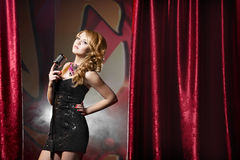 Beautiful woman singing a song with retro microphone. Beautiful glamour woman singing a song with retro microphone Stock Photography