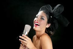 Beautiful woman singing on a vintage microphone Stock Images