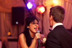 Beautiful woman sings Stock Images