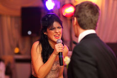 Beautiful woman sings Royalty Free Stock Photography