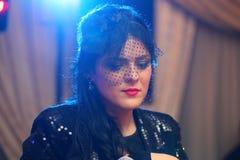 Beautiful woman sings Stock Photography