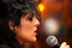Beautiful woman sings Stock Images