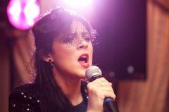 Beautiful woman sings Royalty Free Stock Photo