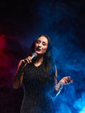 Beautiful woman sings Royalty Free Stock Images