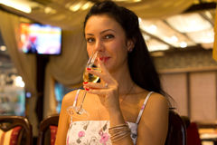 Beautiful woman sipping champagne Royalty Free Stock Photography