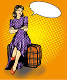 Beautiful woman sit on a bag. Vector illustration in comic retro pop art style. Speech bubble.  Stock Images