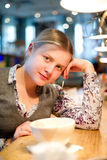 Beautiful woman sit in cafe Royalty Free Stock Photography