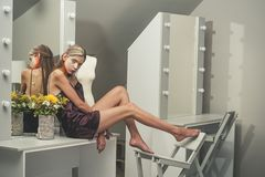 Beautiful woman sit on dressing table before holi party royalty free stock photos